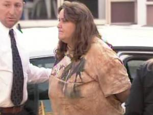 "Crystal Diane Worley, 37, is taken to the Johnston County jail on Dec. 2, 2010, after being charged in the June 8, 2010, death of James E. ""Tom"" Cooper, of Kenly."
