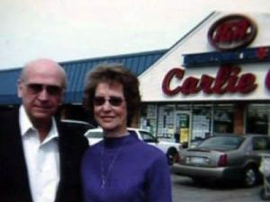 Carlie and Joyce McLamb stand in front of one of their Carlie C's IGA supermarkets in this undated photo.