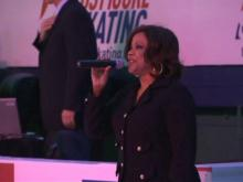 Pam Saulsby sings at figure skating championships