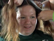 Fayetteville mom shaves head for sons with cancer