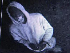 A surveillance image of the man who burglarized The Goat in Raleigh on March 20, 2011.