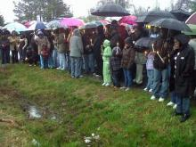 Family and neighbors held a candlelight vigil on March 31, 2011, for a Fuquay-Varina woman whose body was found in a ditch along Lawrence Street.