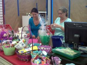 Volunteers assemble Easter baskets with donated candy and gifts in Sanford Friday.