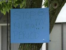 Signs urging an end to violence were posted in the Atka Court neighborhood of Durham on May 11, 2011, a day after 13-year-old Shakanah China was shot to death.