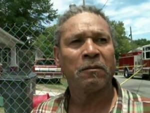 Neighbor Richard Williams said he kicked in the door to check on a family of six that was asleep inside a burning house on Carolina Avenue in Henderson on June 25, 2011.