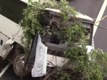 Tour bus wrecks off I-40, killing Wolfpack basketball legend