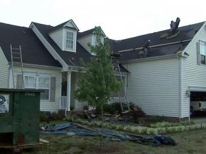 Contractors slowly repair the damage to homes on Serendipity Drive in Raleigh after an April 16, 2011, tornado.