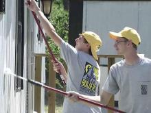 Volunteers repair tornado-wrecked neighborhood