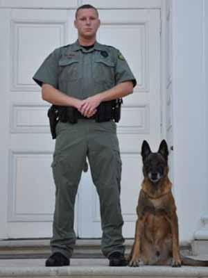 Maverick and his handler, Wake Forrest Officer D. Hess