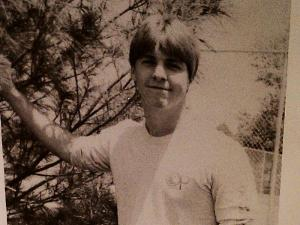 Curtis Mellott attended Ravenscroft High School in Raleigh, where he won a service award and participated in at least one play. This is a yearbook photo taken in 1983.