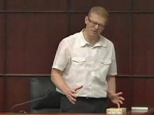 Joshua Stepp, on trial for first-degree murder in the Nov. 8, 2009, death of his 10-month-old stepdaughter, Cheyenne Yarley, demonstrates to jurors during cross-examination how he pushed the child's face into the carpet at their Raleigh home.