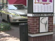 Four injured when car jumps curb at Cameron Village