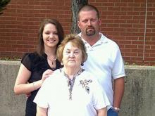Shirley Ann Hodges (center) with her grandson's fiancee and her son-in-law