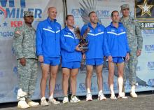 WASHINGTON D.C.— The Fort Bragg men's master team is awarded the Commander's Cup after placing 1st at this year's Army Ten-Miler in Washington D.C. Oct. 9. The men's master team is comprised of four men older than 40. More than 30,000 people and 701 teams competed in the 27th annual 10 mile race. The race is one of the largest 10 mile races in the world. (U.S. Army photo by Sgt. Jessica M. Kuhn, XVIII Airborne Corps PAO)