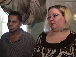A Durham mother told her terrifying story Sunday after she says four men forced their way into her home, held her family at gunpoint and stole about $400 cash, a wallet and a cell phone earlier this week.