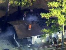Dispatcher discovers house on fire during 911 call