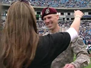 Army Capt. Joe Jorgensen reunites with his wife and family. (Courtesy of Panthervision)