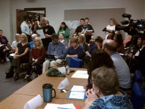 Residents of Cumberland County crowd a meeting to discuss dog adoption policies.