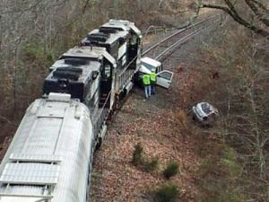 Two men were driving on the railroad tracks near the exit for U.S. Highway 64 off of U.S. Highway 264 in Wendell when a train hit both of their SUVS. They were able to escape without injury.
