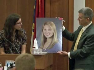 Orange County District Attorney Jim Woodall holds a photo of Eve Carson as he examines her former roommate, Anna Lassiter, on Dec. 7, 2011.
