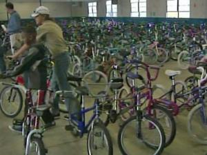 Moses Mathis gives away more than 1,000 refurbished bikes to needy children in Fayetteville each Christmas.