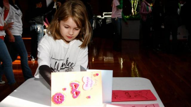 8-year-old Bailey works on making a Valentine's Day card for troops during the United Way's Martin Luther King Jr. Day of Service at the American Tobacco District in Durham.