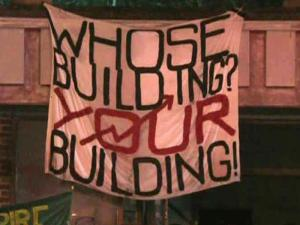 A protest group calling itself Carrboro Commune took over a vacant downtown building Saturday that they hoped would become a community center, but was recently purchased by the CVS Corporation.