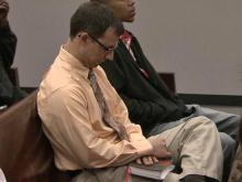 Jerrod McCabe holds onto his Bible before appearing in court on child pornography charges on March 8, 2012.