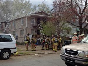 Crews battle a residential fire at 613 Quarry St. in southeast Raleigh on March 13, 2012.