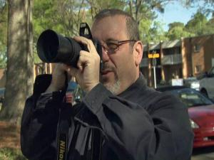 Neighbor Bob Meekins was taking pictures Saturday of the devastation at Mayfair Mews.