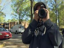 Doug Loucka was taking pictures Saturday of the devastation at Mayfair Mews.