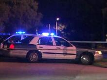 Raleigh police cars guard a crime scene at 4911 Hollendon Drive, where a woman was found shot shortly before 10 p.m. on April 27, 2012.