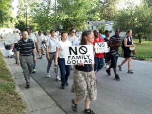Dozen of neighbors surrounding the future site of a Family Dollar store in Carrboro marched to a town meeting Thursday to voice their opposition to the project.