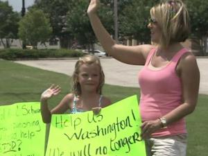 An Army wife staged a personal protest along a busy Fayetteville thoroughfare on Monday, trying to draw attention to what she says is inadequate care by the Army of soldiers suffering from post-traumatic stress disorder.