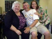 Hugh Armstrong is reunited with his wife and daughter in Marion, N.C., on Aug. 11, 2012, more than two weeks after he disappeared while walking around a New Hampshire lake.