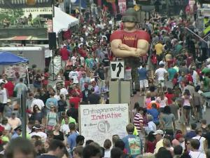 Students, alumni and fans crowded a Hillsborough Street alive with music, dance and sports demonstrations Saturday, Aug. 18, 2012, to celebrate North Carolina State University's 125th anniversary.