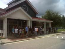 At least three dozen people line up in front of the SPCA of Wake County on Monday, Aug. 20, 2012, to adopt some of the 39 dogs seized from a Brunswick County puppy mill earlier in the month. (Photo by Tara Lynn)