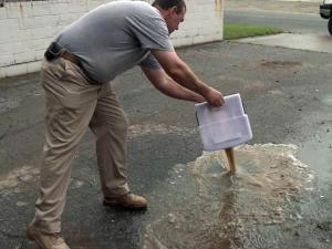 Nearly 4 inches of rain pummeled Roanoke Rapids on Aug. 19, 2012, and much of it found its way into Chris Moseley's business on 12th Street.