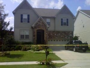 Crime scene tape surrounds 1718 Kinsley Place on Aug. 30, 2012, after a shooting at an apartment complex seven miles away.
