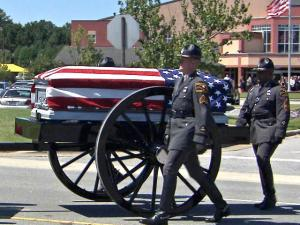 The body of Trooper Bobby Gene DeMuth arrives by a horse-drawn carriage at Englewood Baptist Church in Rocky Mount on Sept. 12, 2012. DeMuth died in the line of duty on Sept. 8, 2012.