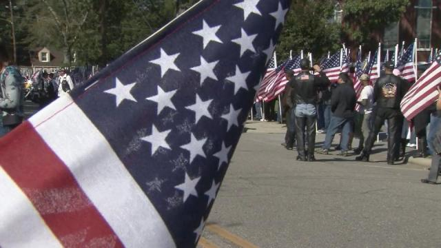 Neighbors and strangers lined the streets in Raeford to pay respects to Sgt. Donna Johnson, killed in Afghanistan.