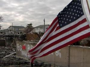 A U.S. flag is the only thing standing in the charred remains of a home destroyed during Hurricane Sandy in the New York town of Breezy Point.