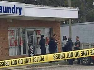 Crime scene tape cordons off the Line Up Barber Shop, at 6376 Yadkin Road, on Nov. 20, 2005.