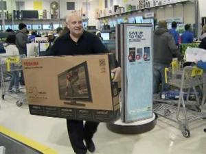 Gary Patterson carries a 40-inch television out of the Garner Best Buy Friday, Nov. 23, 2012.