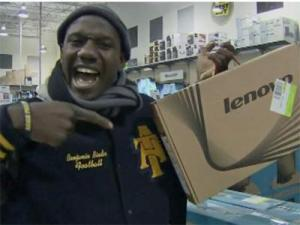A shopper shows off a Lenovo laptop Friday, Nov. 23, 2012 at the Garner Best Buy.
