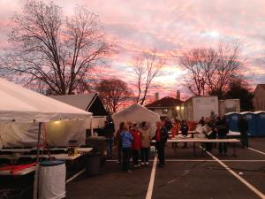 Durham Rescue Mission founder Ernie Mills, right, speaks with volunteers early Monday as the sun rises on preparations at the annual Christmas meal and toy giveaway.