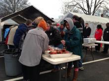 Volunteers prepare turkeys for the 2012 Christams Eve dinner for needy families, hosted by the Durham Rescue Mission.