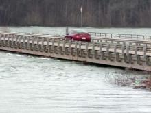 Waves on Kerr Lake lapped against the underside of the bridge at Nutbush Road on Jan. 24, 2013.