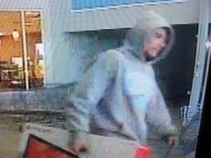 Clayton police released an image captured from a security video of a person suspected of robbing a Walmart on Jan. 31, 2013. Police say the thief later stole a car and injured a woman in a hit-and-run accident.