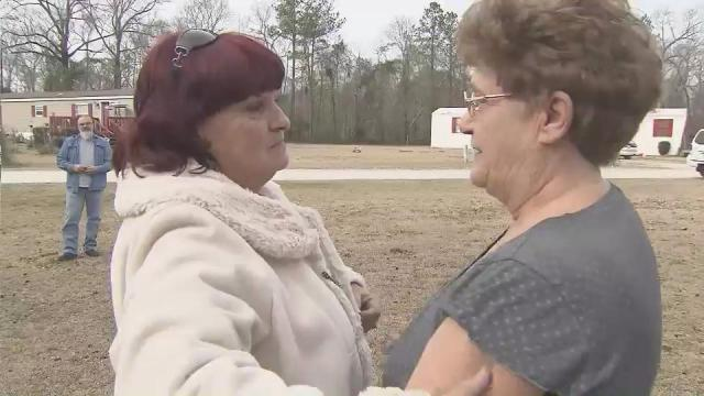 Sisters Patricia Rogers, left, and Bonnie Russell reunited Thursday after more than 50 years apart.